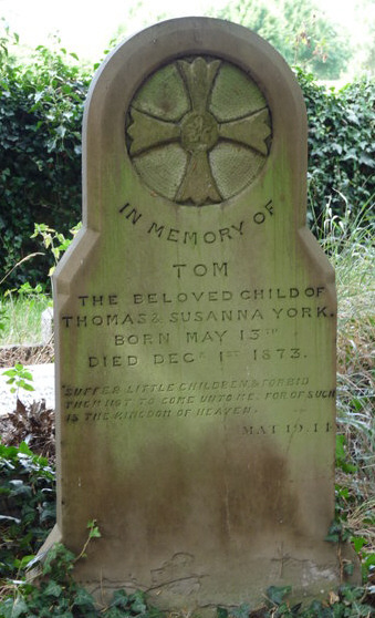 A grave stone in the cemetery of All Saints Church